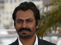 """Indian actor Nawazuddin Siddiqui poses on May 18, 2013 during a photocall for the film """"Monsoon Shootout"""" presented Out of Competition at the 66th edition of the Cannes Film Festival in Cannes. Cannes, one of the world's top film festivals, opened on May 15 and will climax on May 26 with awards selected by a jury headed this year by Hollywood legend Steven Spielberg. AFP PHOTO / VALERY HACHE"""