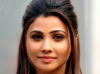 """Indian Bollywood actress Daisy Shah attends a promotional event for the Hindi film """"Jai Ho"""" in Mumbai on January 23, 2014. AFP PHOTO/STR"""